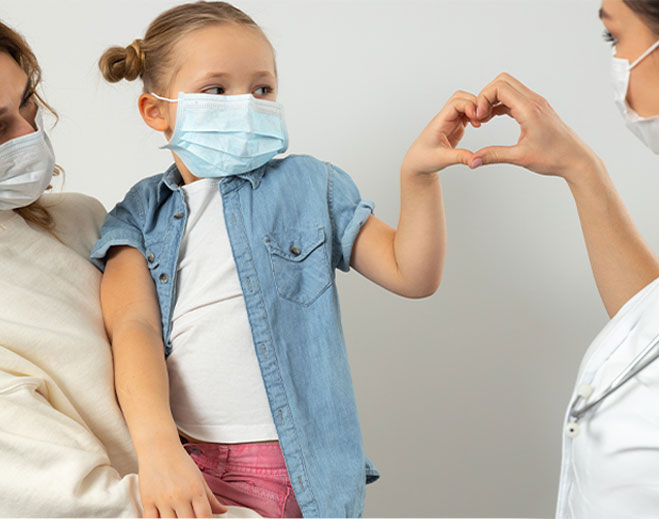 child holding heart hands with a nurse
