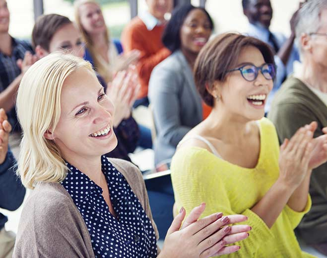 award-applauding-women-coworkers